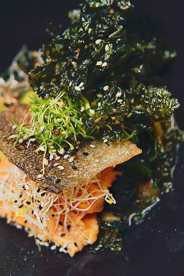 Poached trout in broth with sea lettuce