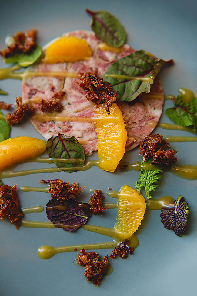 Pork mosaic with orange and a vanilla vinaigrette