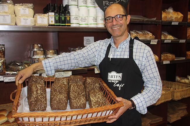 John Martins holding his car free bread