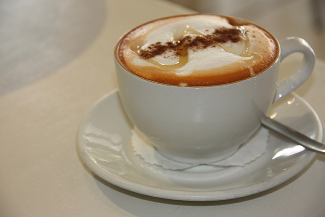 Red cappuccino with honey