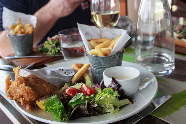 Beer battered hake and chips served with a mix garden salad and tartare sauce