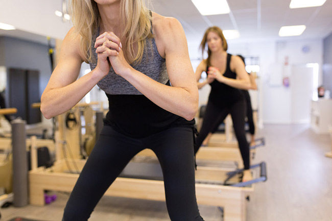 A group equipment class at Flex Pilates studio