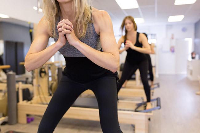 A group equipment class at Flex Pilates studio