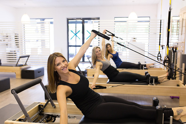 Crystal demonstrates an exercise on the reformer