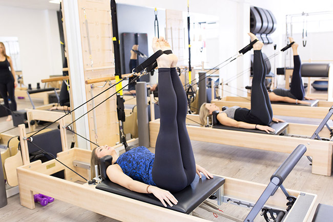 A leg workout using the reformer ropes