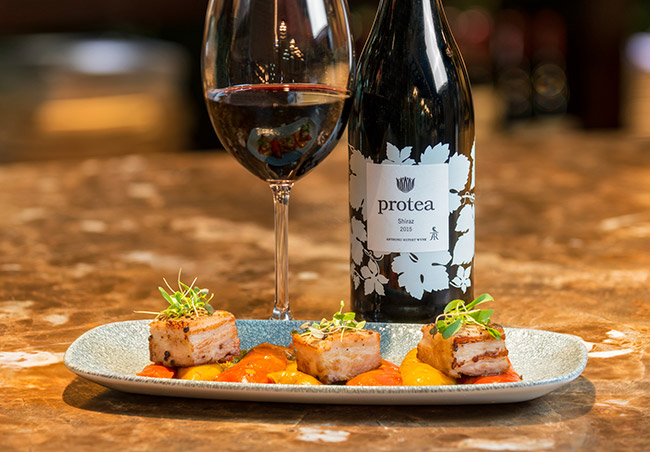Protea Shiraz paired with pork belly.