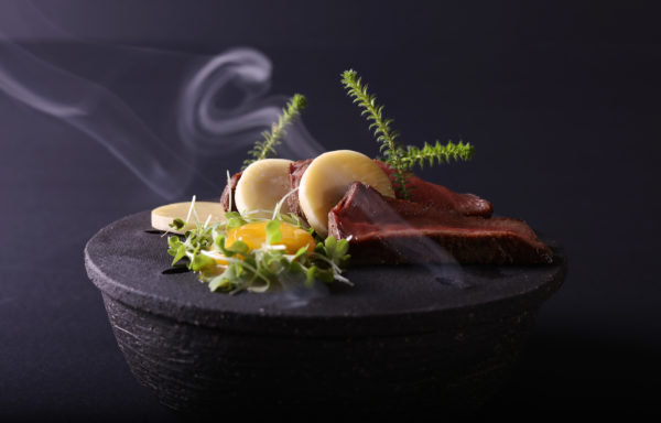 Tintswalo Atlantic (Rooibos smoked kudu, ocean water cured egg yolk, wild garlic smoked skattie cheese)