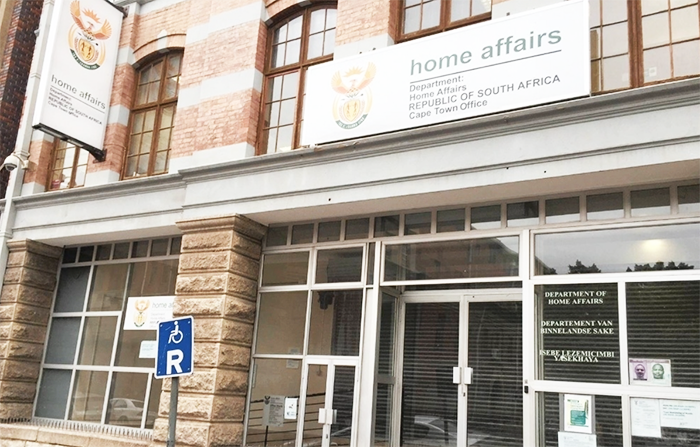 Minister tackles issue of long queues at Home Affairs