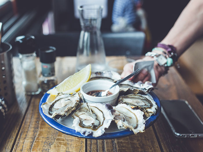 Pop champagne at the annual Knysna Oyster Festival