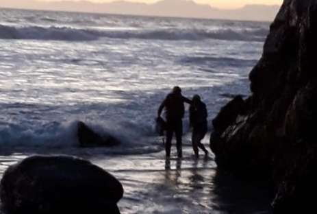 Teenagers trapped in cove by high tide