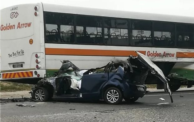 Two killed after car is wedged under bus
