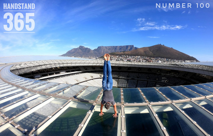 Man handstands on top of Cape Town Stadium